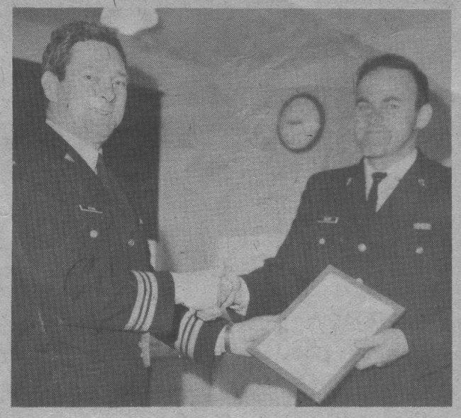 Major Harold Bitcom presents a Merit Award to WO S Eslinger - June 1976