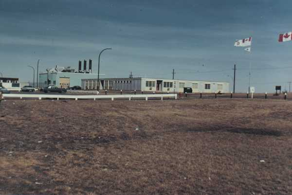 Headquarters building and power plant in background - 1985